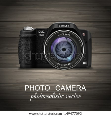 Isolated modern photorealistic photo camera with blue lens on wooden background. Vector illustration. - stock vector