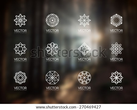 Line art logo template set. Vector geometric monogram symbols on blurred background - stock vector