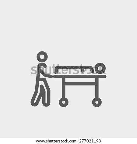 Man pushing the stretcher with sick person icon thin line for web and mobile, modern minimalistic flat design. Vector dark grey icon on light grey background. - stock vector
