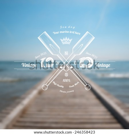 marine background with paddles cross label on blue pier ocean blur photo - stock vector