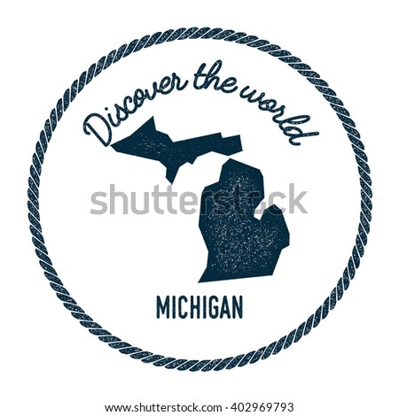 Michigan map in vintage discover the world rubber stamp. Hipster style nautical postage stamp, with round rope border. Vector illustration. - stock vector