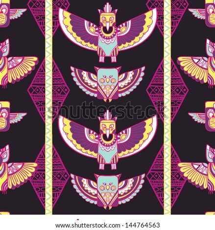 Native american indigenous ornamental seamless pattern background with feathers and totem poles. - stock vector