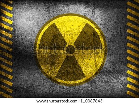 Nuclear radiation symbol on grunge wall. Vector background - stock vector