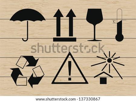 Packing symbols set on wooden background. Vector illustration - stock vector