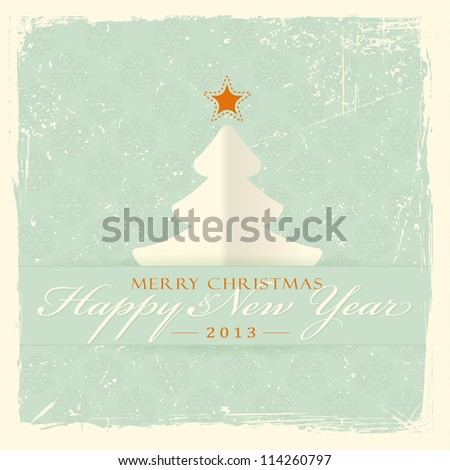 Paper Christmas tree with red star and label with the wording 'Merry Christmas and Happy New Year' on distressed pale green background with filigree seamless snowflake pattern. - stock vector