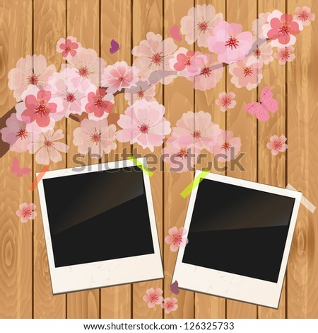 photo frame on wooden texture with cherry flowers - stock vector
