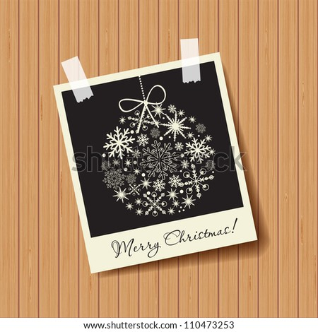 Photo frame with snowflakes ball on wooden background. Christmas concept - stock vector