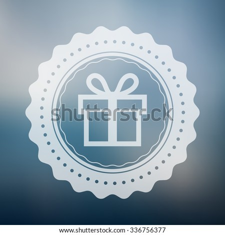 Present badge vector with rounded designs placed on a blue blur background. Christmas gift logo on a defocused blue background.. - stock vector
