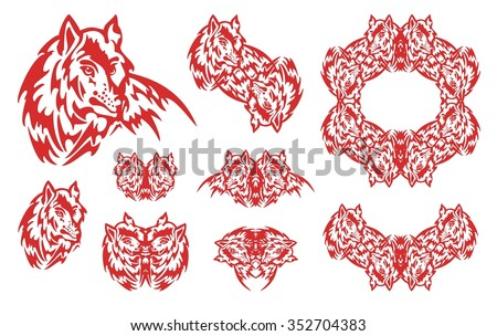 Red wolf symbols. Set of the flaming symbols of the wolf head and wolf frame in tribal style - stock vector