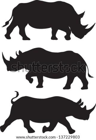 Rhino silhouette vector set of three - stock vector