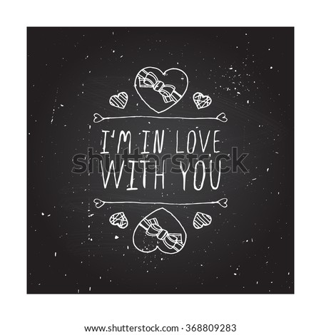 Saint Valentines day greeting card.  I am in love with you. Typographic banner with text and doodle heart shaped chocolate candies on chalkboard background. - stock vector