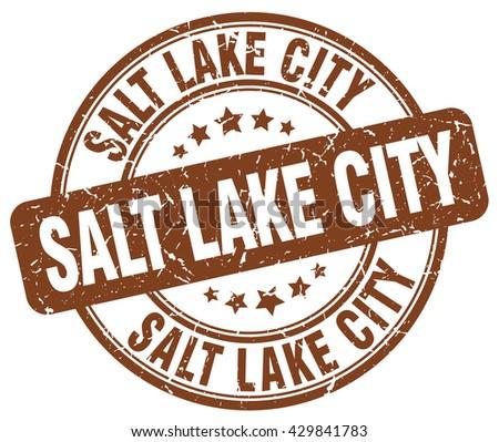 Salt Lake City brown grunge round vintage rubber stamp.Salt Lake City stamp.Salt Lake City round stamp.Salt Lake City grunge stamp.Salt Lake City.Salt Lake City vintage stamp. - stock vector