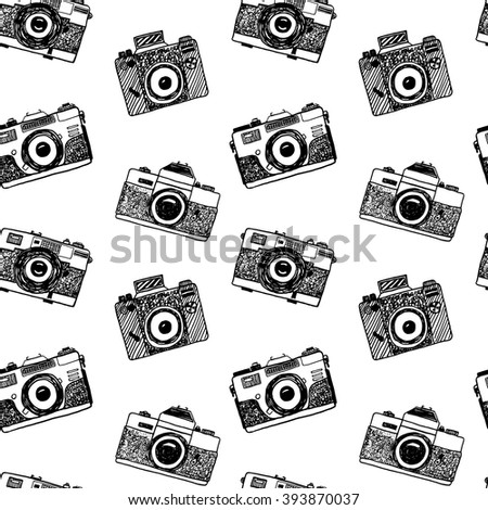 Seamless background with sketch retro photo cameras - stock vector