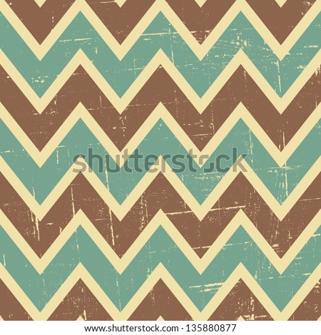 Seamless chevron pattern in blue, brown and beige. - stock vector