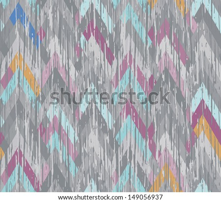 Seamless herringbone inlay. Texture scratched the surface. Asymmetrical multicolored zigzag. - stock vector