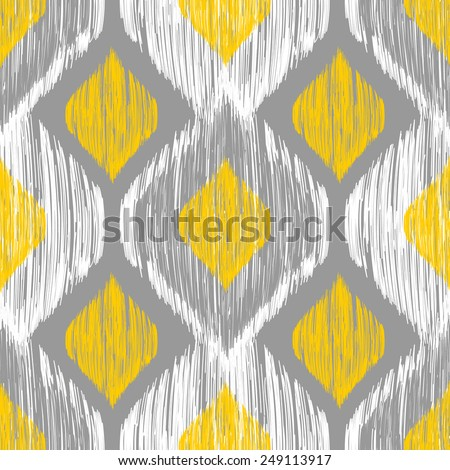 Seamless ikat pattern in yellow and grey colors. Vector tribal background - stock vector