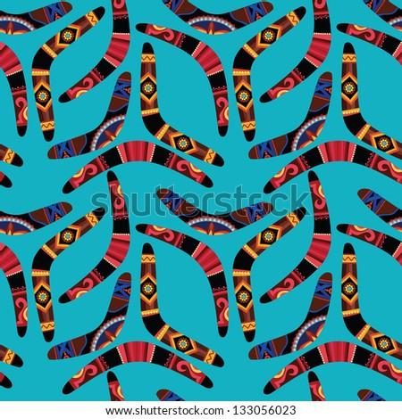 Seamless pattern with boomerangs on blue background - stock vector