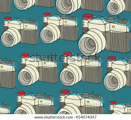 Seamless pattern with old photo cameras. Vector repeated background. - stock vector