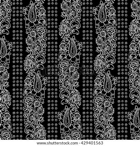 Seamless vector striped paisley pattern. Ethnic floral motif with stripes of flowers and blocks, primitive oriental elements, white on black background. - stock vector