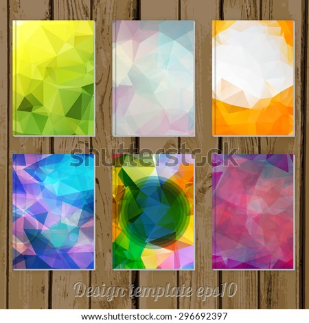 set of Abstract geometric colorful cover designs from triangular faces on wooden background - stock vector