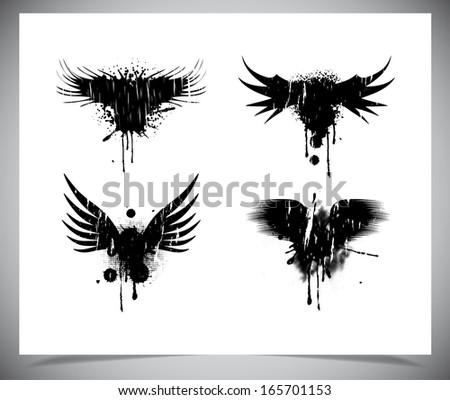 Set of black grunge wings. Vectro illustration - stock vector