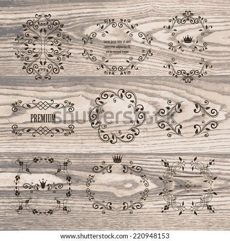 set of dark brown retro styled ornamental designs. frames with crowns for your photo or sample text. isolated on wooden background. vector illustration. can use for birthday card, wedding invitations - stock vector
