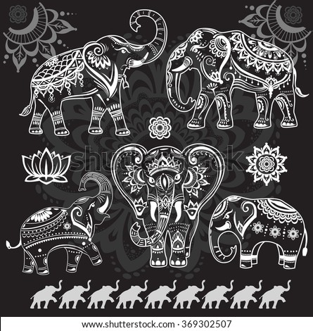 Set of decorated elephants on black - stock vector