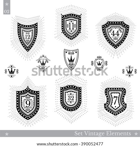 Set of different geometric shields with light ray. Hipster vintage style templates for business signs, labels, logos, identity, badges, apparel, shirts, stickers and other branding objects - stock vector
