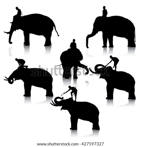 Set of editable vector silhouettes of elephant and mahout young boy on white background - stock vector