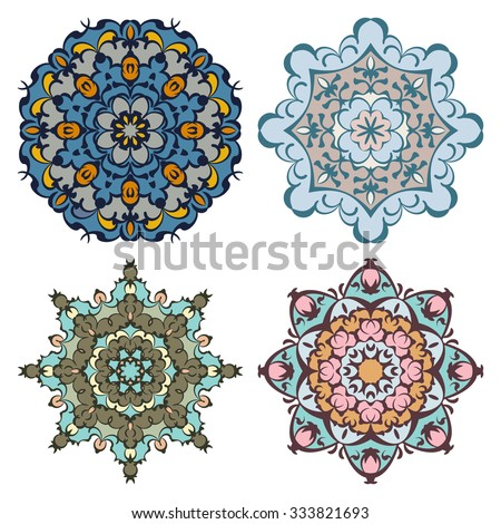 Set of four cold color eastern round ornaments mandalas isolated over white - stock vector