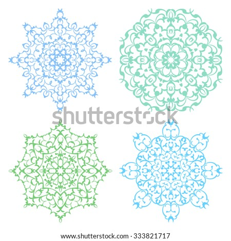 Set of four cold color lacy eastern round ornaments mandalas isolated over white - stock vector