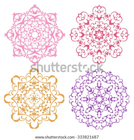 Set of four warm color lacy eastern round ornaments mandalas isolated over white - stock vector
