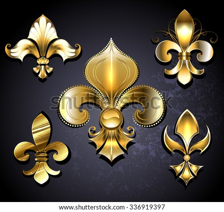 Set of gold, jewelry Fleur de Lis on a black background.