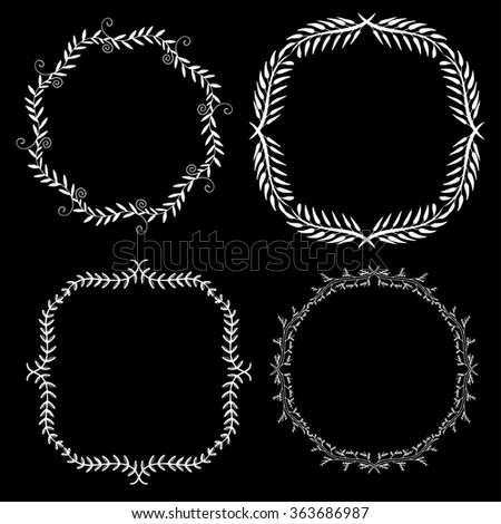 Set of hand drawn decorative frames. A set of four decorative frames. Set of decorative doodle wreaths made of branches. Black background. Black and white. - stock vector