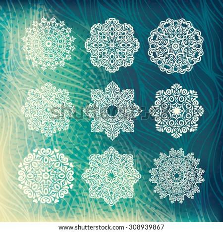 Set of 9 hand drawn snowflakes, detailed elegant design. Vintage background - stock vector