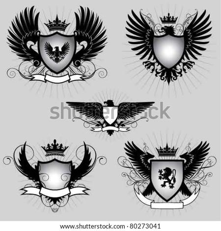 Set of heraldry winged shield - stock vector