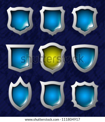 Set of nine steel glossy lightened shields - stock vector
