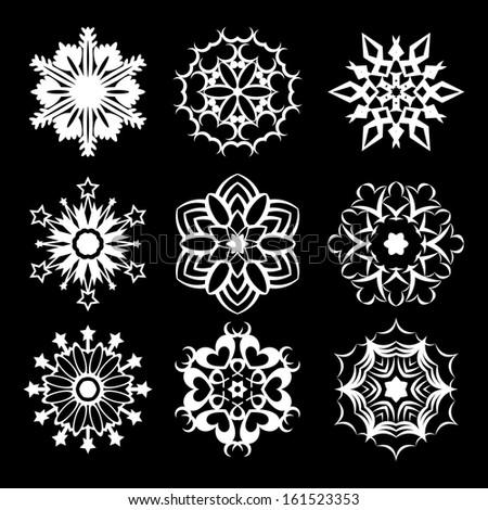 Set of nine white snowflakes on black background. eps10 - stock vector