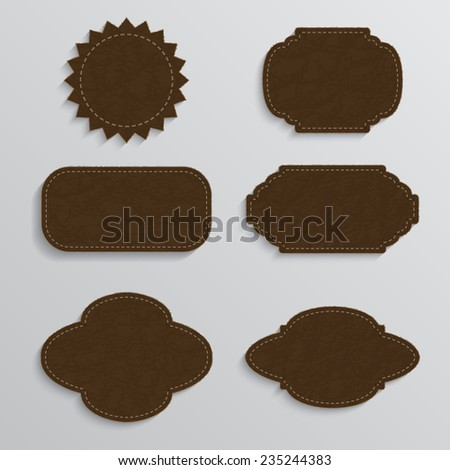 Set of realistic leather jeans labels, leather tags.  - stock vector