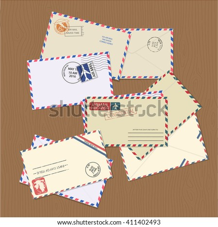 Set of vintage air mail envelopes with stamps, postal elements and copy space for text on wooden table. Minimal vector illustrator.  - stock vector