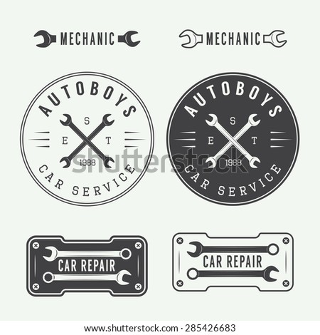 Set of vintage mechanic labels, emblems and logo. Vector illustration - stock vector