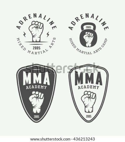 Set of vintage mixed martial arts or fighting club logos, emblems, badges, labels, marks and design elements. Retro graphic art. Vector Illustration.   - stock vector