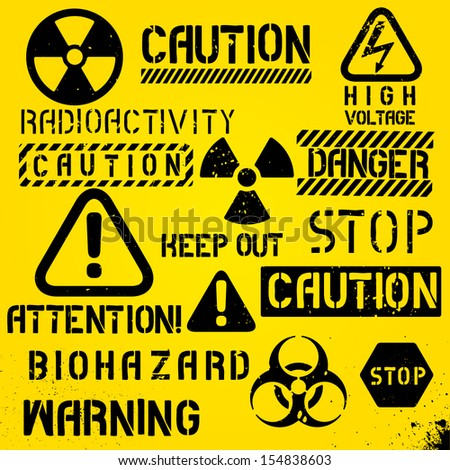 Set of warning hazard symbols and text - stock vector