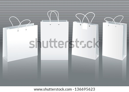 Set of white paper bags in different positions - stock vector