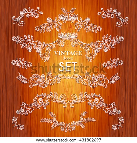 Set  vector hand drawn calligraphic element. The pattern of the branches of the roses. Wooden background. border Floral ornament of leaves and flowers.Vintage style. - stock vector
