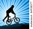 Silhouette of bicyclist - stock vector
