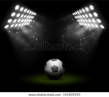 Soccer ball in light of searchlights. Illustration contains transparency and blending effects, eps 10 - stock vector