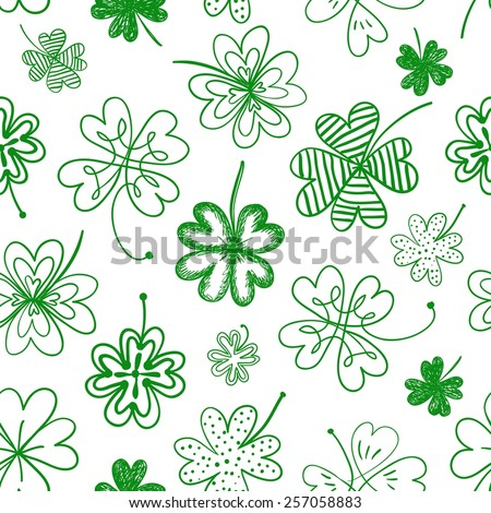 St. Patrick's day doodle seamless background with four leaf clover  - stock vector