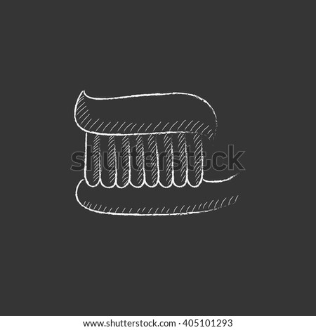 Toothbrush with toothpaste. Drawn in chalk icon. - stock vector