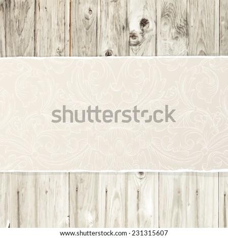Torn paper on wooden texture - stock vector